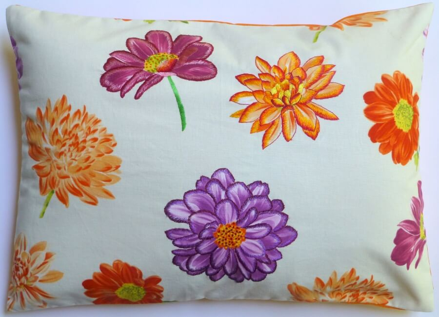 A hand embroidered cushion cover